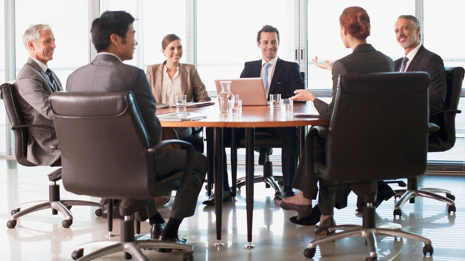 A company meeting at a board table